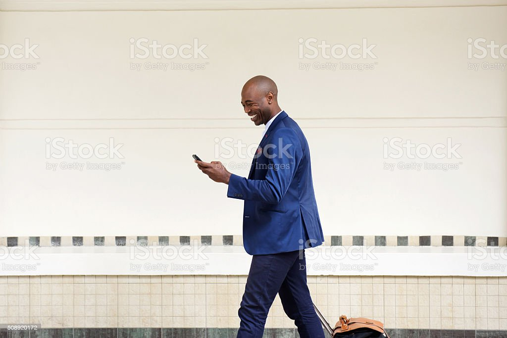 Business man traveling with a bag and mobile phone stock photo