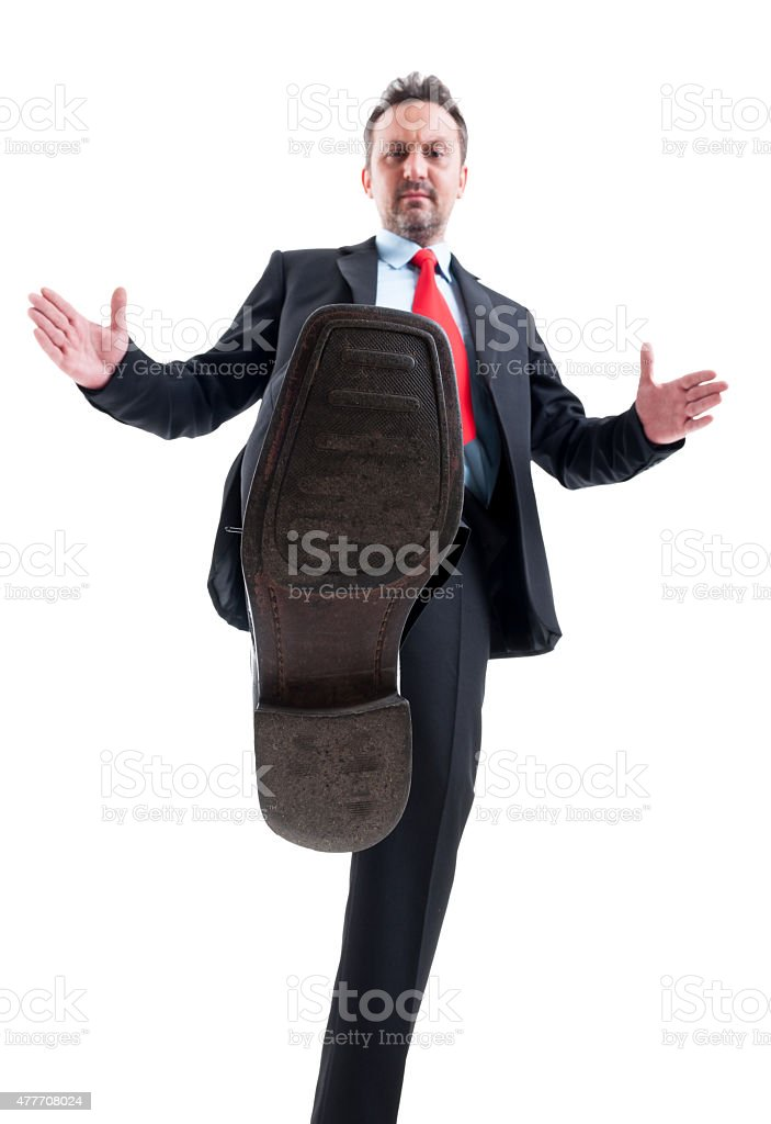 Business man treading on competitors stock photo