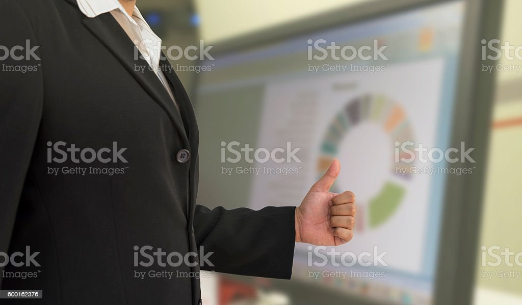business man tumb up for success graph stock photo