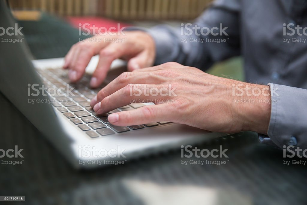 Business man typing email on laptop stock photo