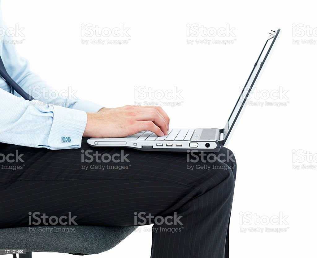 Business man typing on a laptop isolated on white royalty-free stock photo