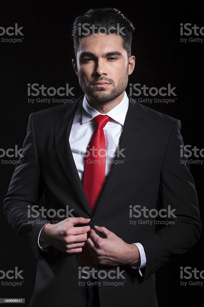 business man unbuttons his jacket stock photo