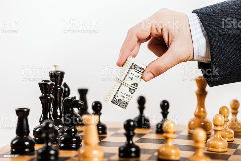 Business man unfair playing chess game stock photo