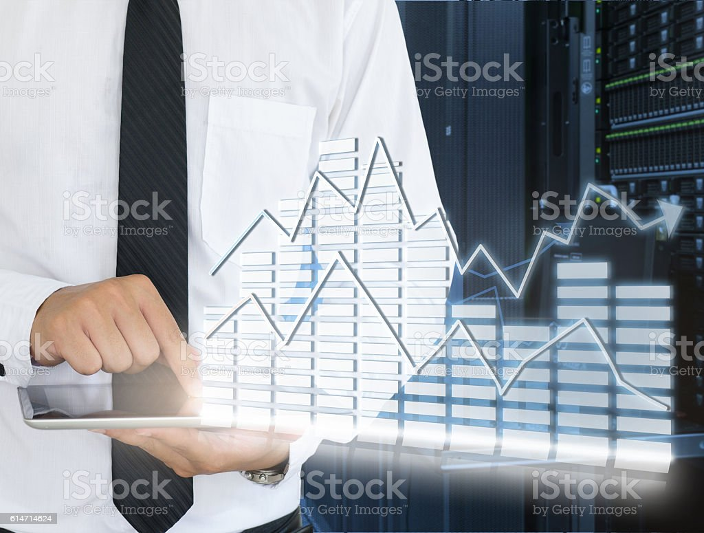 Business man use tablet for analyze in data center stock photo