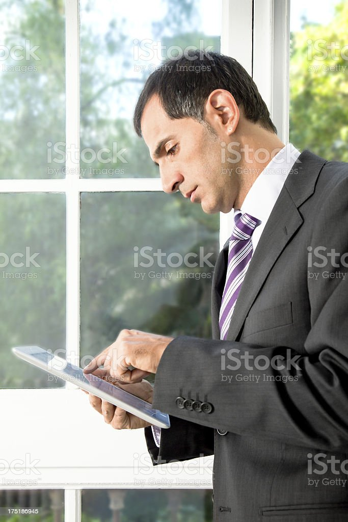 Business man using a digital tablet royalty-free stock photo