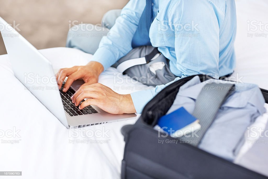 Business man using a laptop on the bed royalty-free stock photo