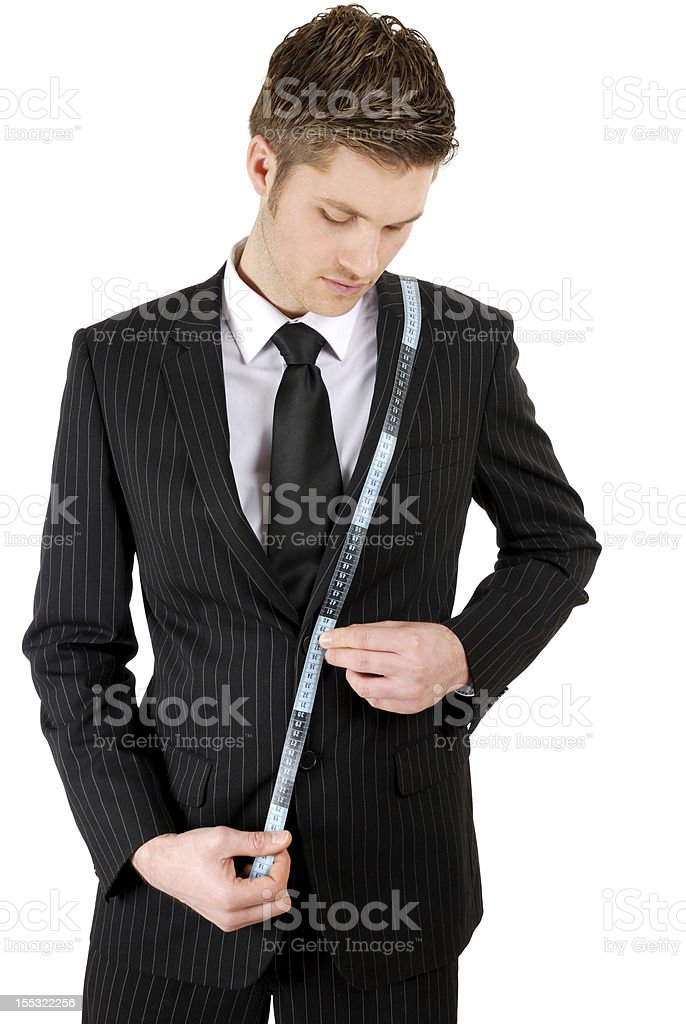 Business man using a measuring tape royalty-free stock photo