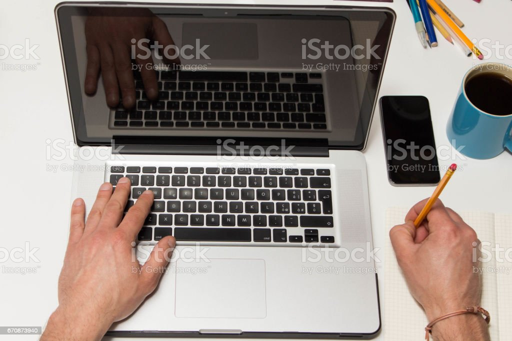 Business man using laptop and smartphone on his desk stock photo