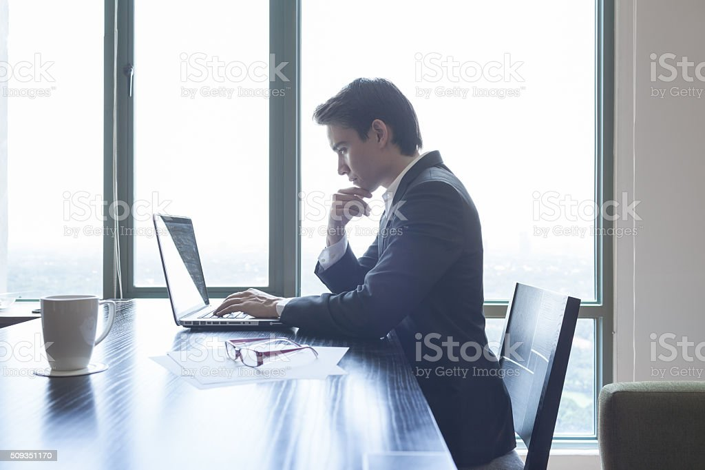 Business man using laptop computer stock photo