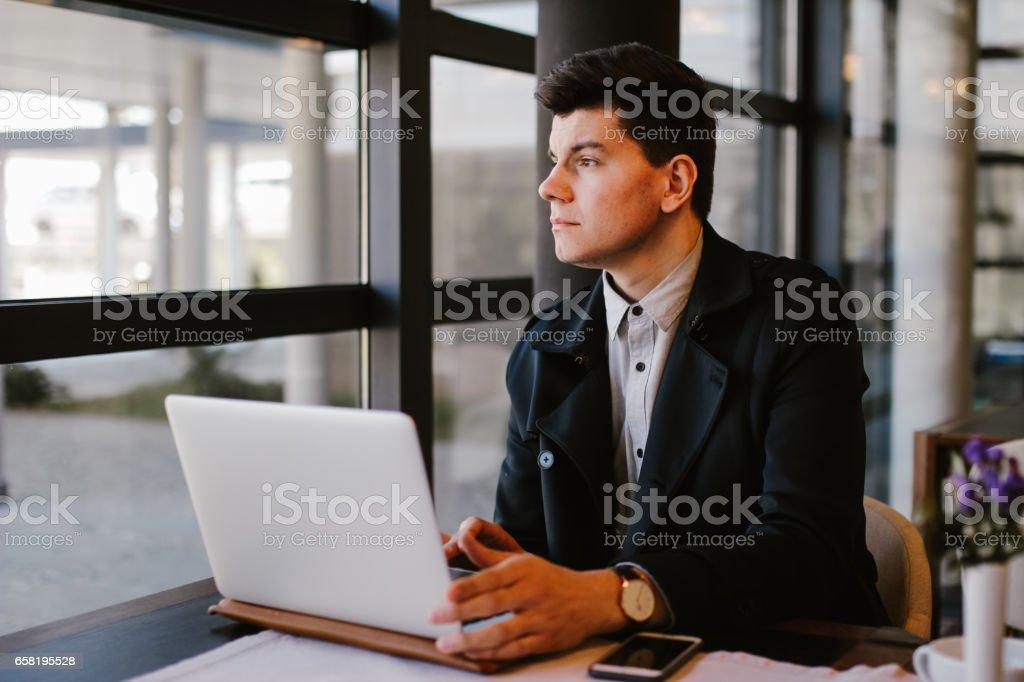 Business man using laptop stock photo