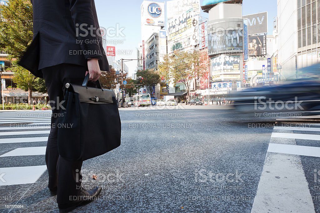 Business man waiting to cross the street royalty-free stock photo