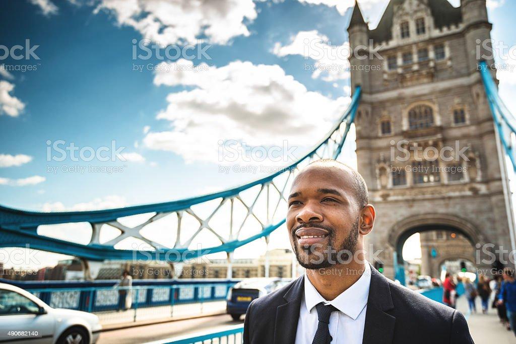 Business man walking at tower bridge in London stock photo