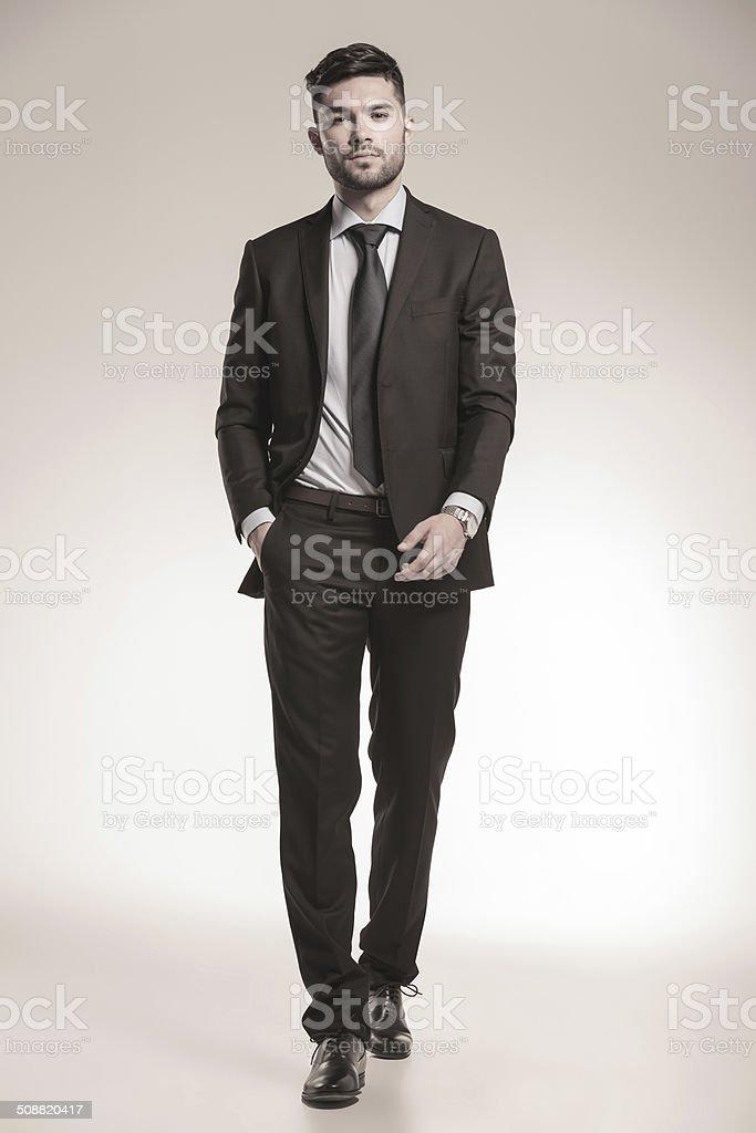 business man walking forward stock photo