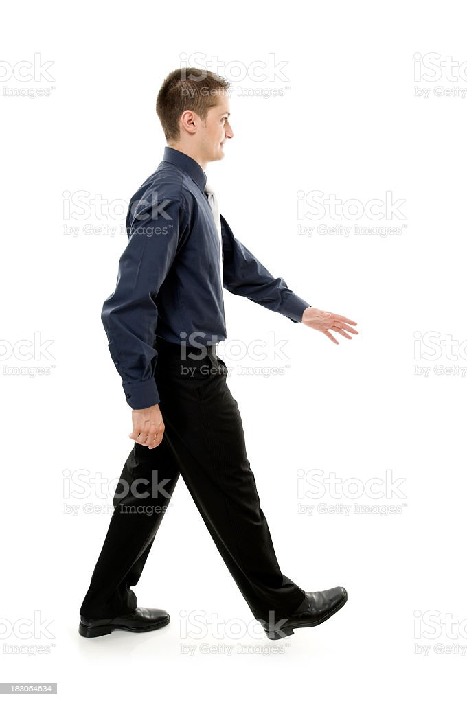 Business man walking, isolated on white stock photo