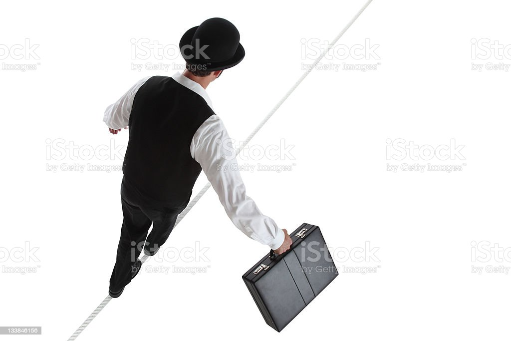 Business Man Walking on a Tightrope royalty-free stock photo