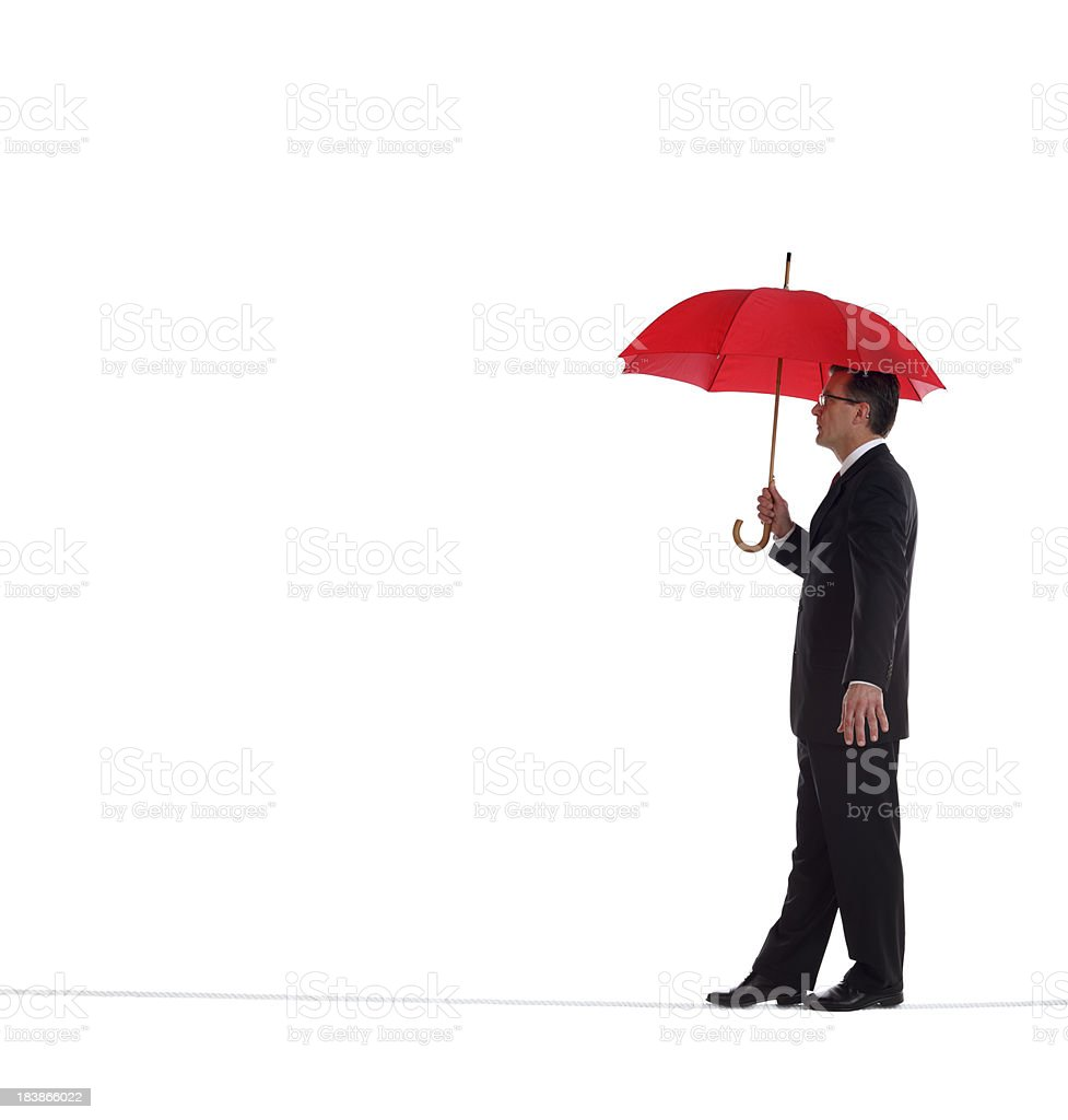 Business Man Walking on a Tightrope stock photo