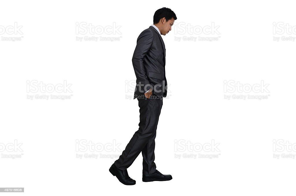 Business man walking stock photo