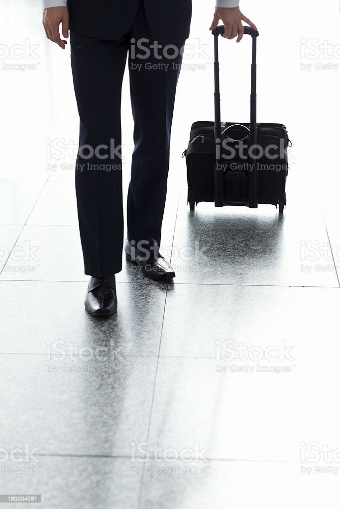 Business Man Walking With His Luggage At Airport royalty-free stock photo