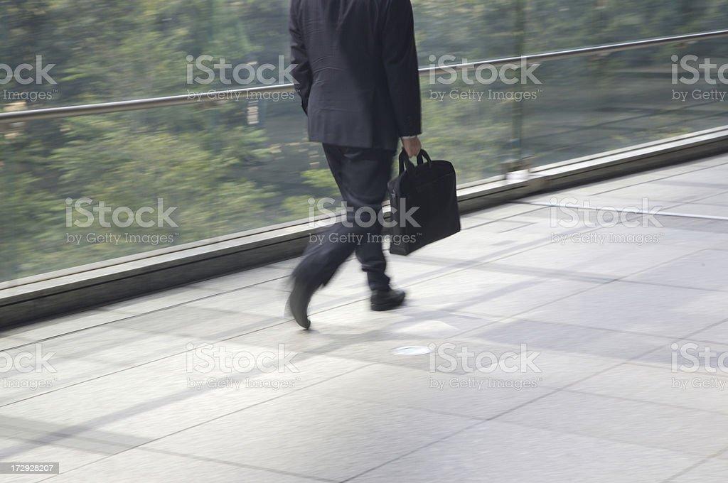 Business man walks hand in pocket stock photo