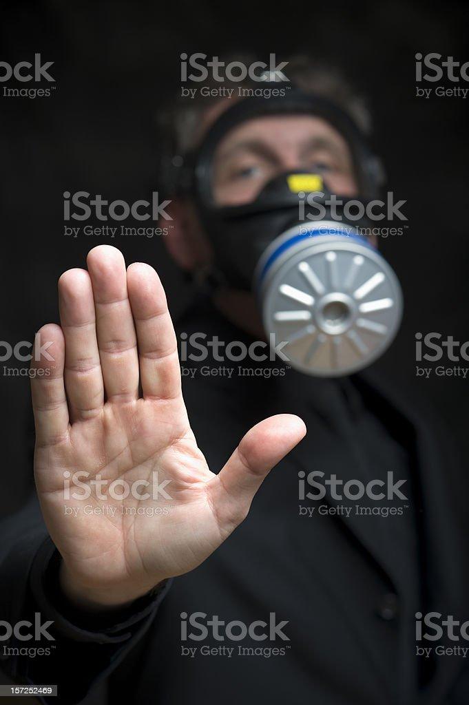 Business man wearing a gas mask. stock photo
