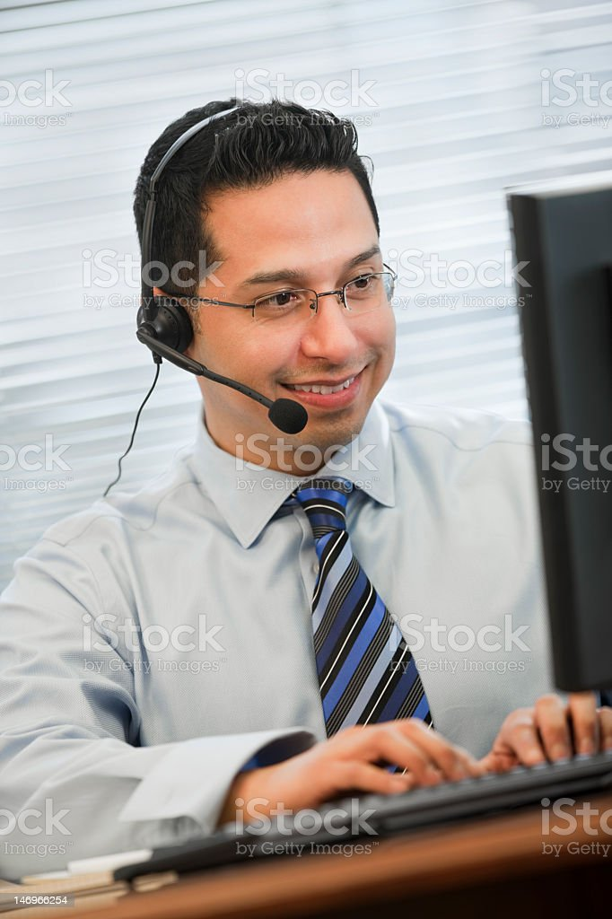 Business Man Wearing Headset Working At Computer royalty-free stock photo