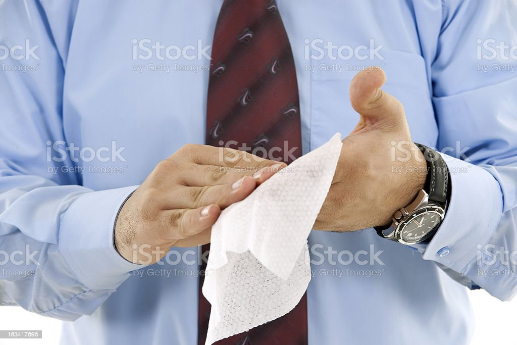 business man wipes his hands royalty-free stock photo