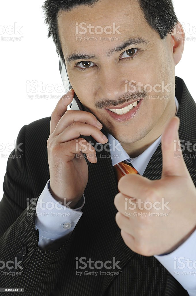 Business Man wishing Good Luck with Handy stock photo