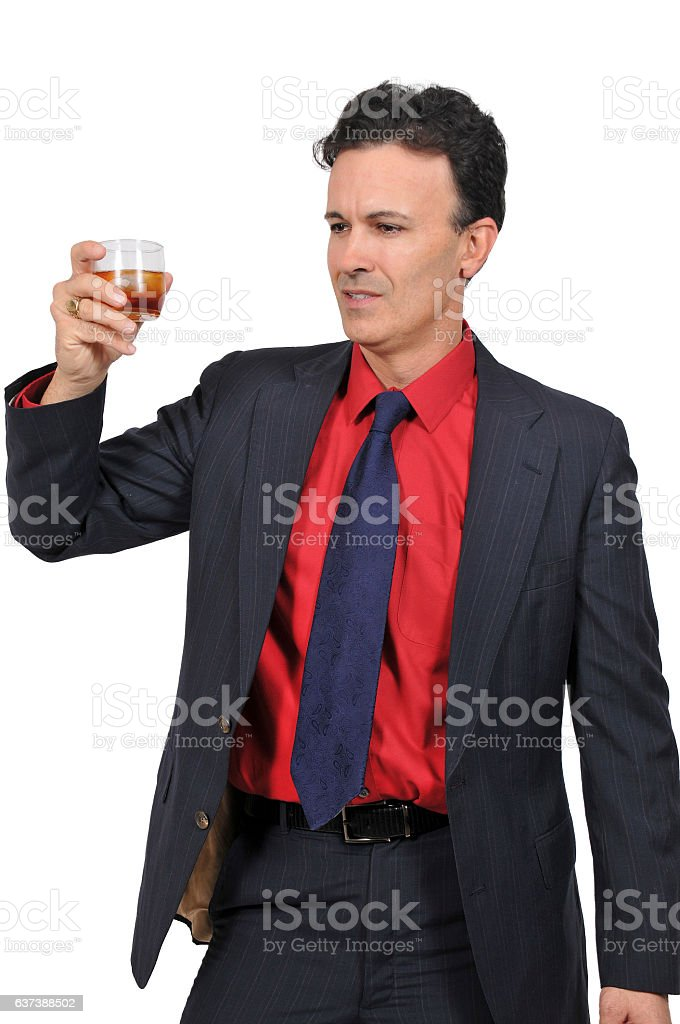 Business man with a cocktail stock photo