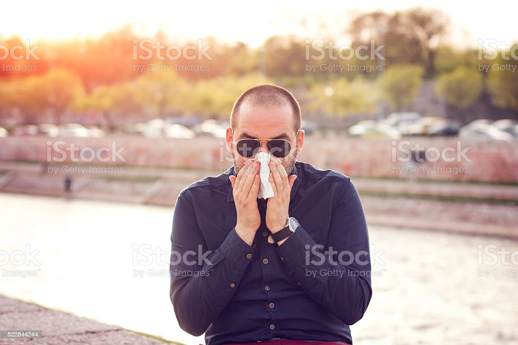 Business man with a flue stock photo