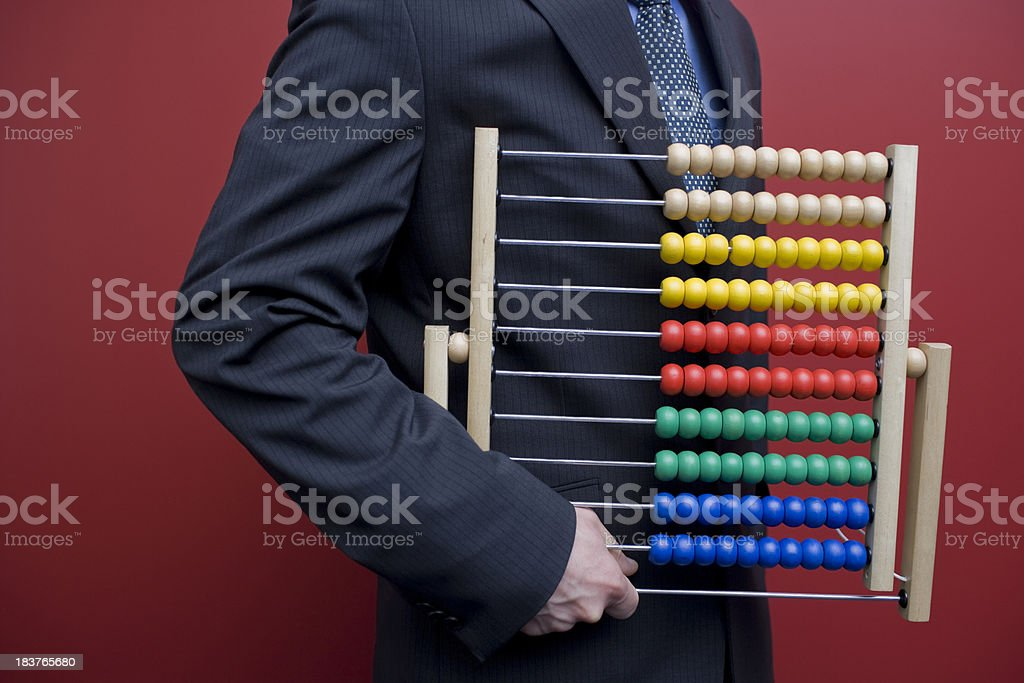 Business man with Abacus stock photo