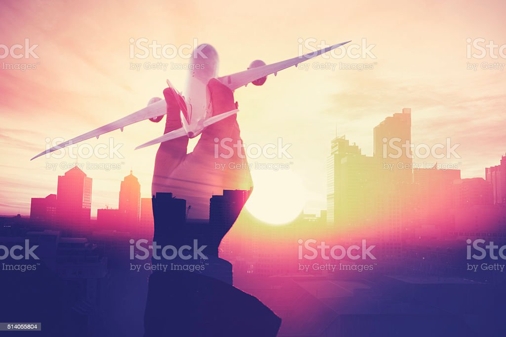 Business man with airplane with cityscape montage. stock photo