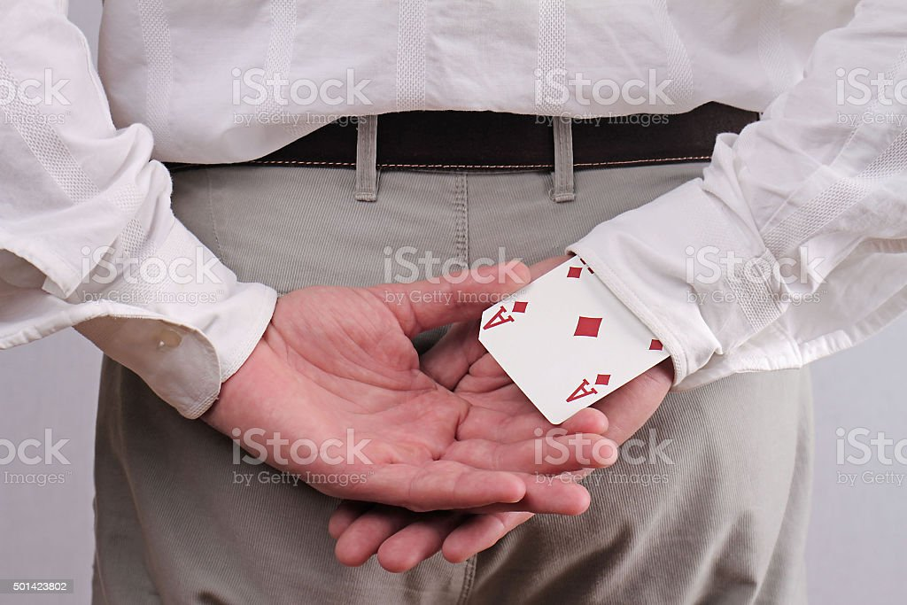 Business man with an ace up his sleeve. stock photo