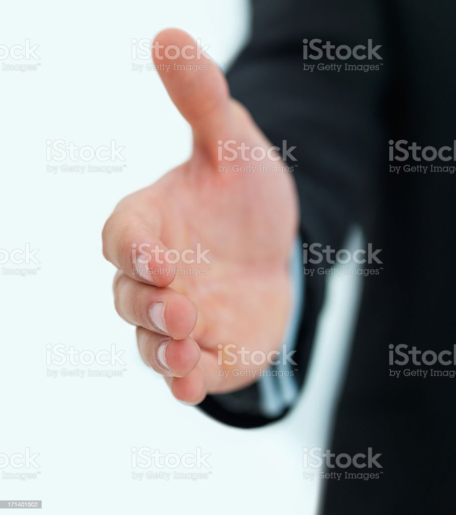 Business man with an open hand ready to seal a deal isolated on white background royalty-free stock photo