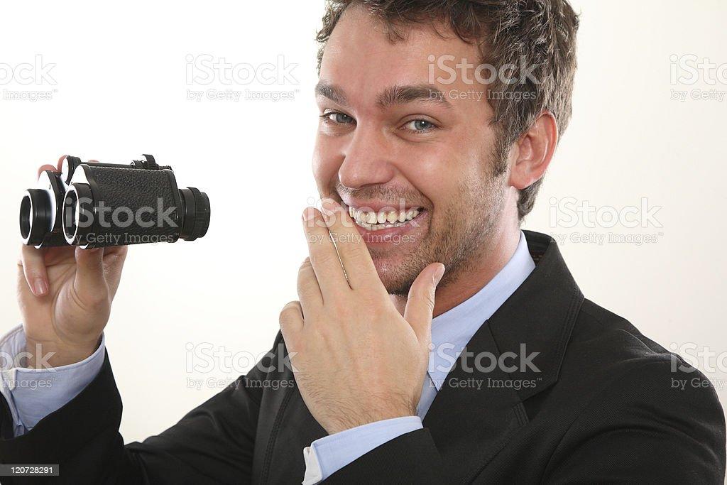 Business man with binoculars stock photo