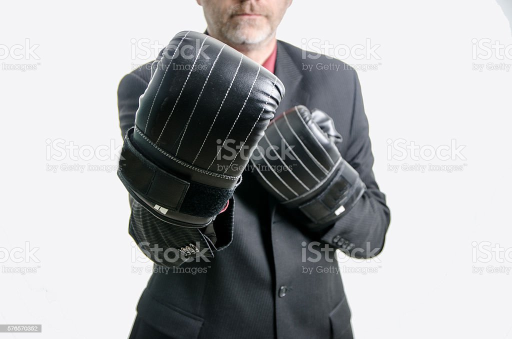 Business man with boxing gloves stock photo
