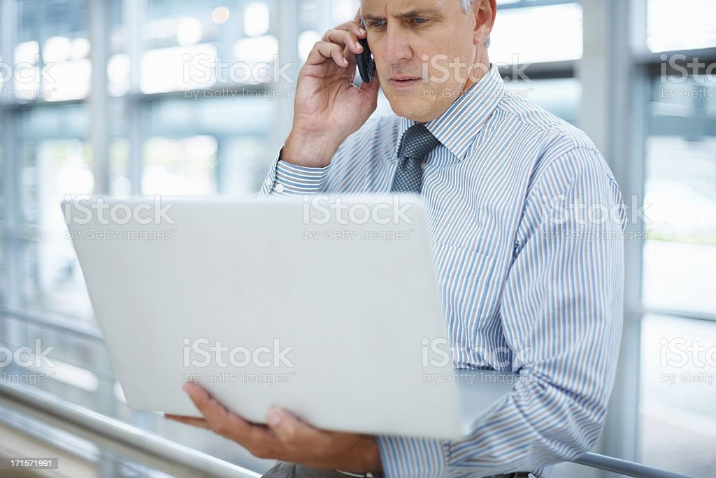 Business man with cell phone and laptop royalty-free stock photo