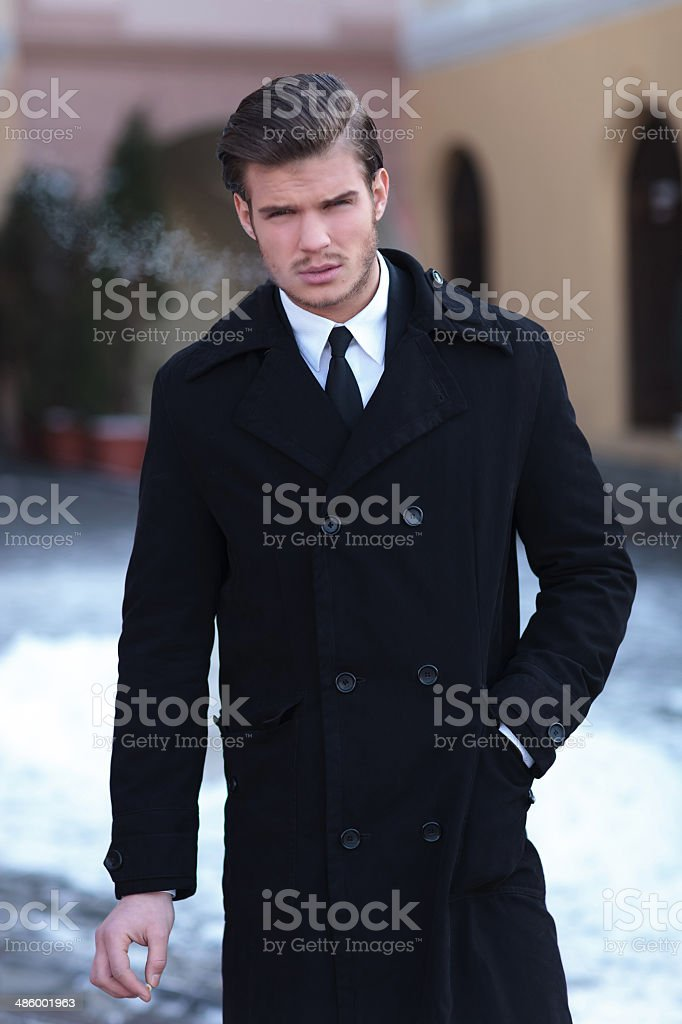 business man with cigarette in hand stock photo
