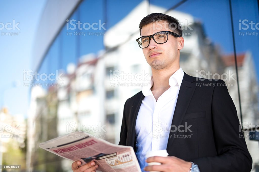 Business Man With Coffee and Newspaper stock photo