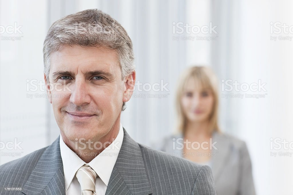 Business man with colleague at the back royalty-free stock photo
