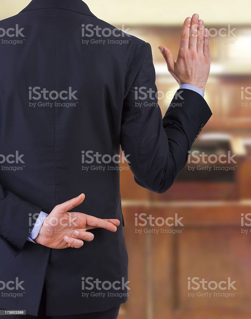 Business man with fingers crossed. stock photo