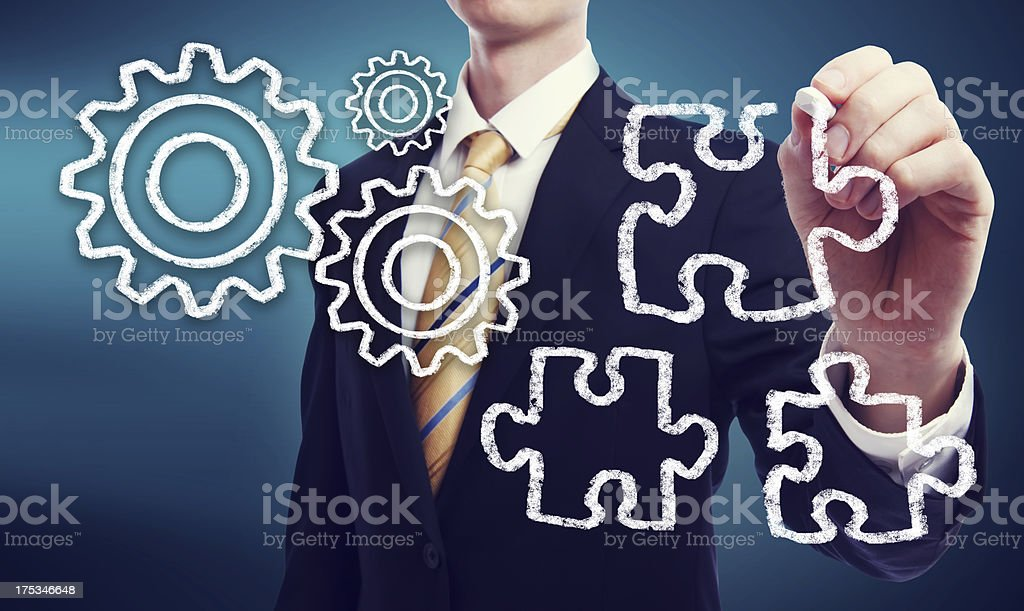 Business Man with Gears and Puzzle Pieces royalty-free stock photo