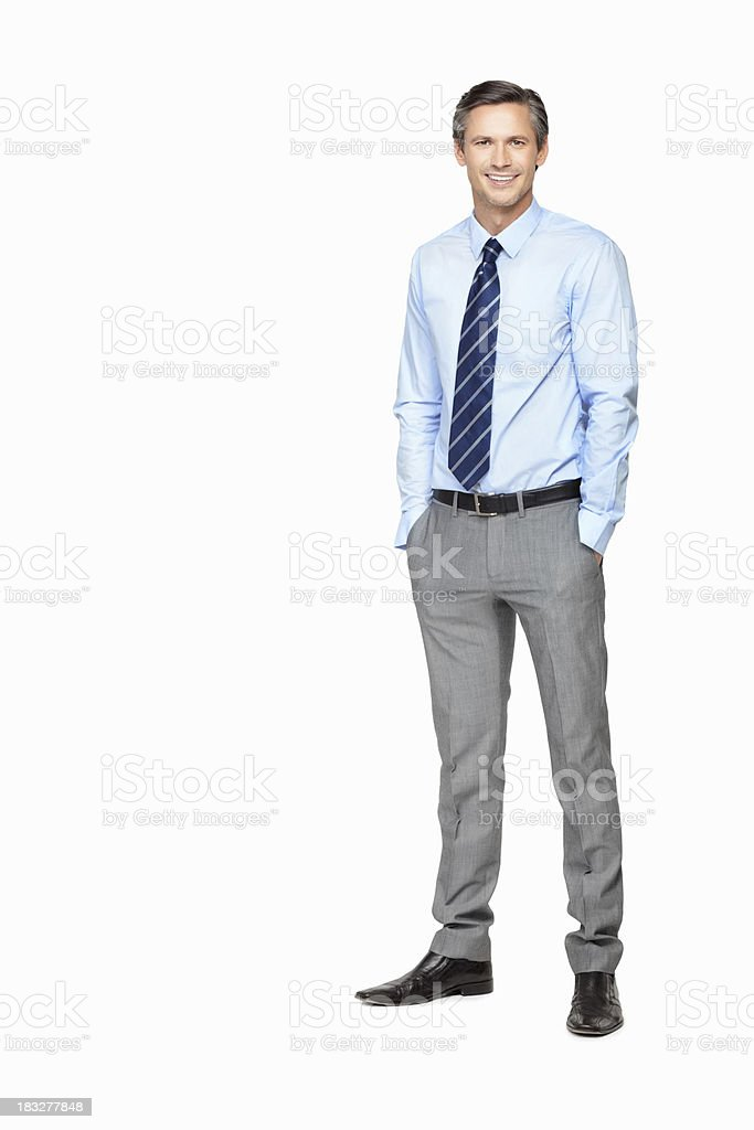 Business man with hands in pockets against white royalty-free stock photo