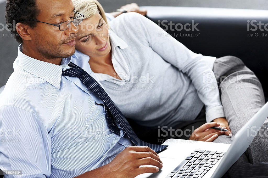 Business man with his girlfriend working on laptop royalty-free stock photo
