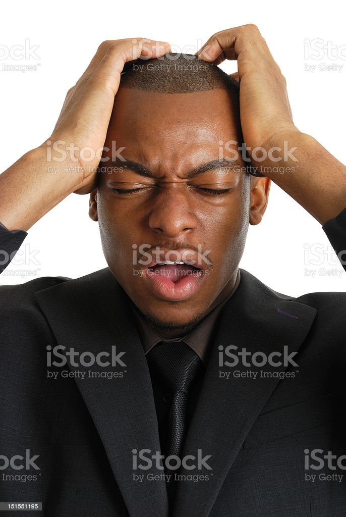 Business man with his hands on head due to failure royalty-free stock photo