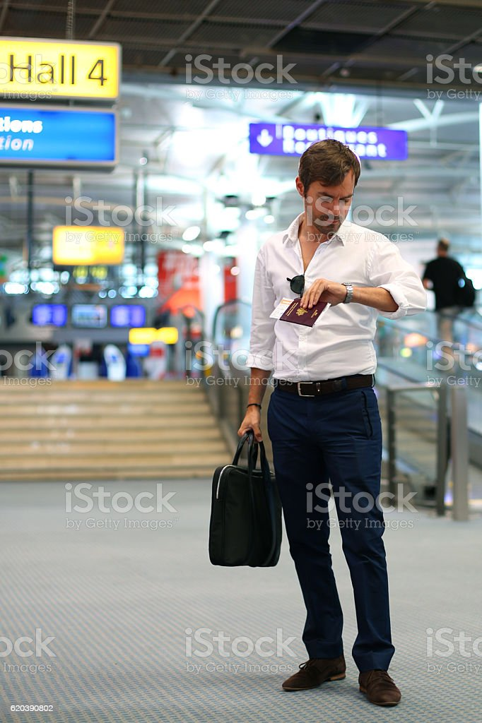 Business man with his passeport in the airport stock photo