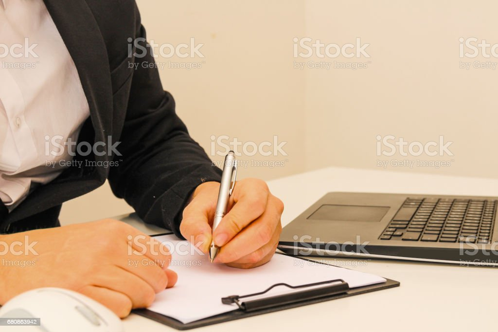 Business man With laptop and documents in the office stock photo