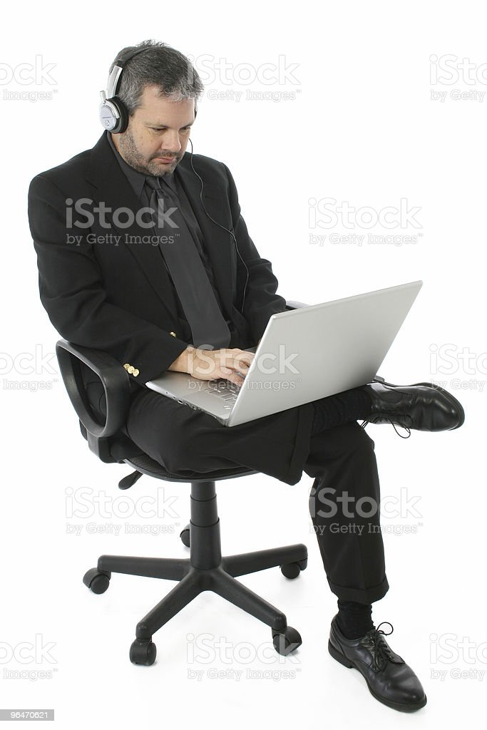 Business Man with Laptop and Headphones stock photo