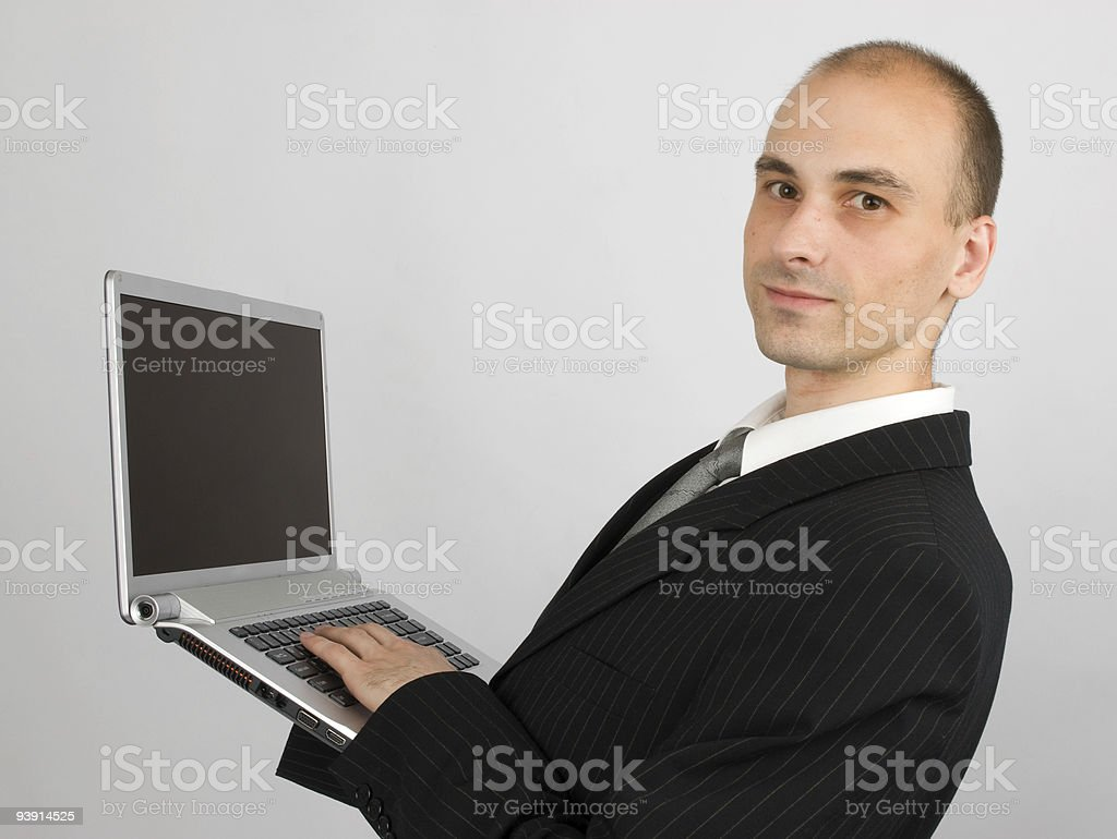 business man with laptop stock photo