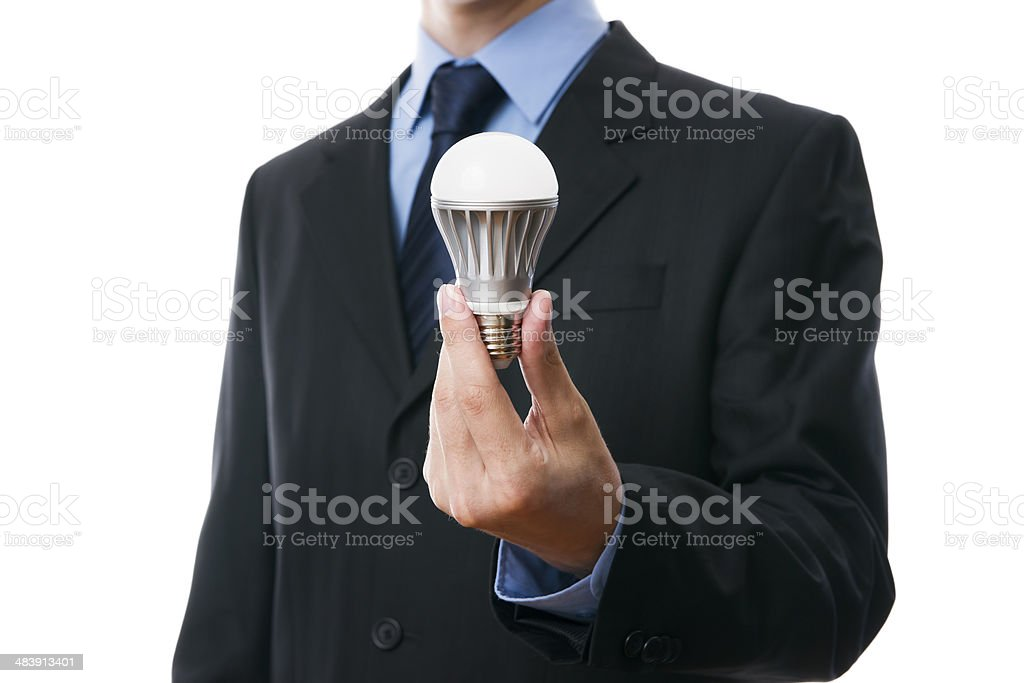 Business man with LED light bulb stock photo