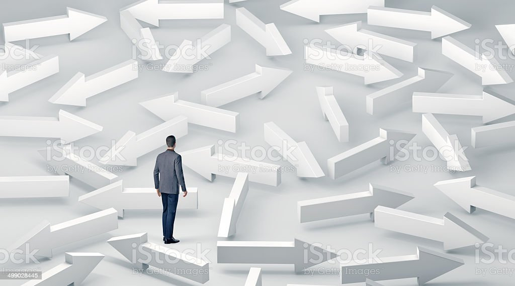 Business man with lots of choices stock photo